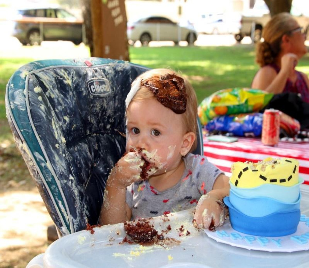 baby with cake on its face