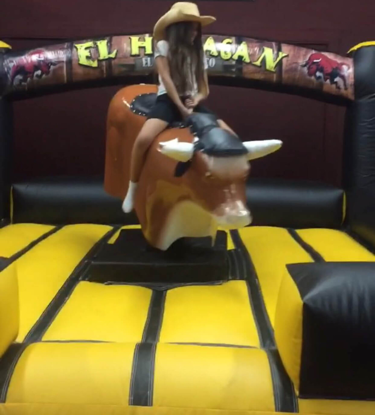 Mechanical Bull With Attendant
