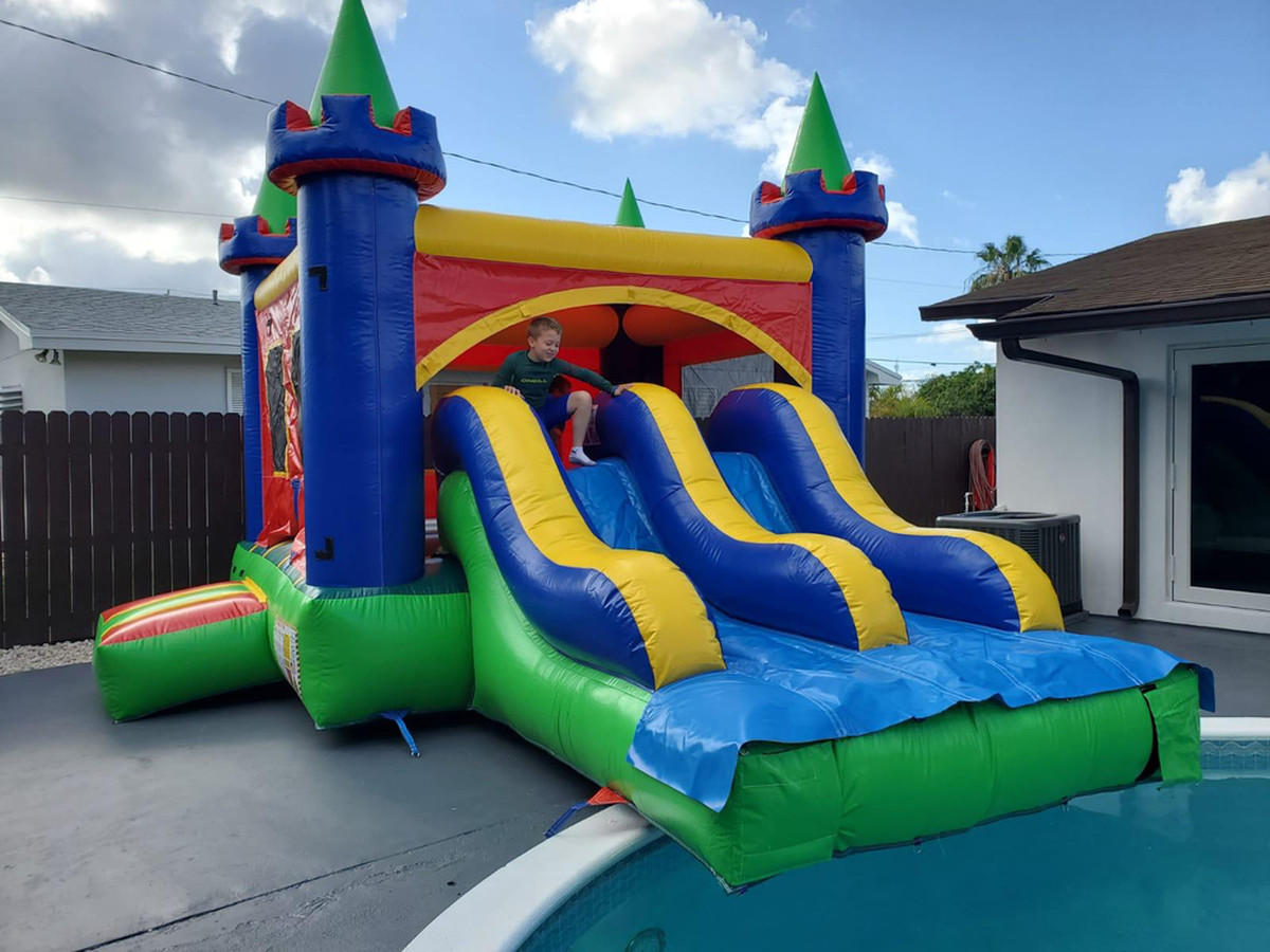 Combo castle double slide into pool 13' wide x 22' long